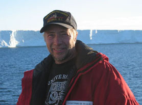 Jack DiTullio in front of iceberg